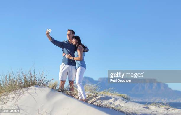 a Young couple spending time together on a Cape Town beach.