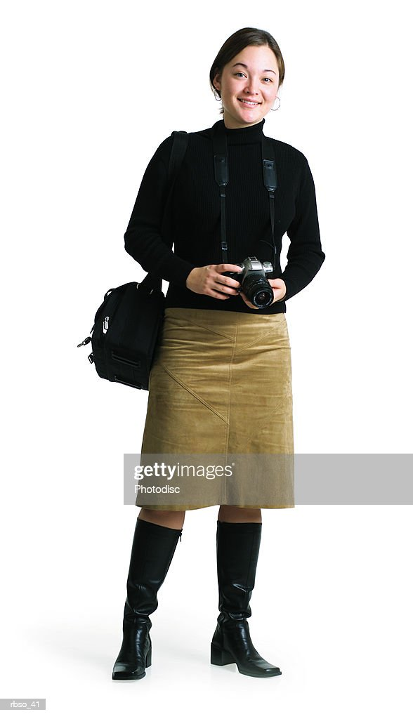 a young ethnic female photographer holds her camera and smiles : Foto de stock