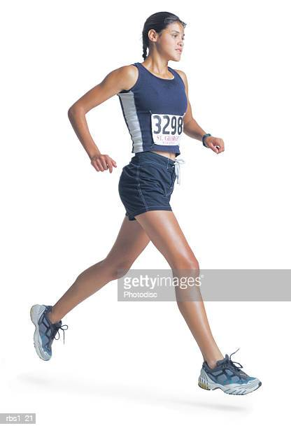 a young ethnic woman in a blue track uniform is wearing a marathon number and running