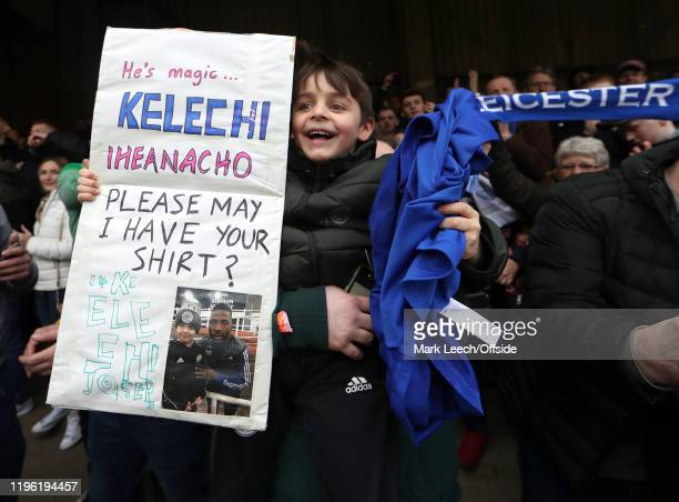 a young fan gets the shirt of his hero Kelechi Iheanacho of Leicester after the FA Cup Fourth Round match between Brentford FC and Leicester City at...