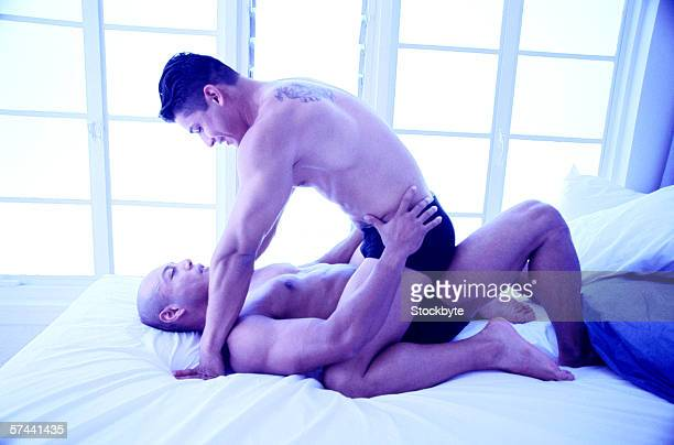 a young gay man sitting on top of his partner (tungsten)