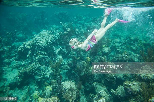 a young girl diving with a snorkel, BVI