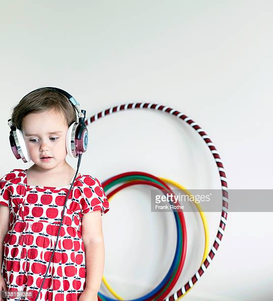 a young girl wears headphones and listen to music - musik stock pictures, royalty-free photos & images