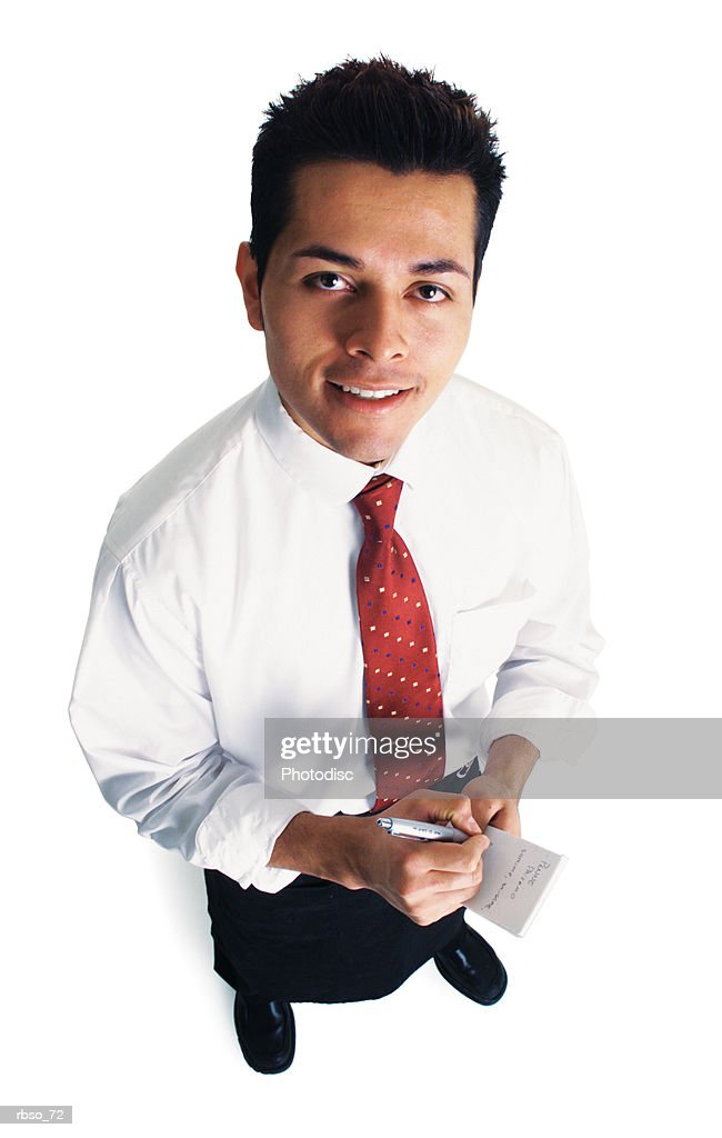 a young hispanic waiter prepares to take an order as he looks up at the camera : Foto de stock
