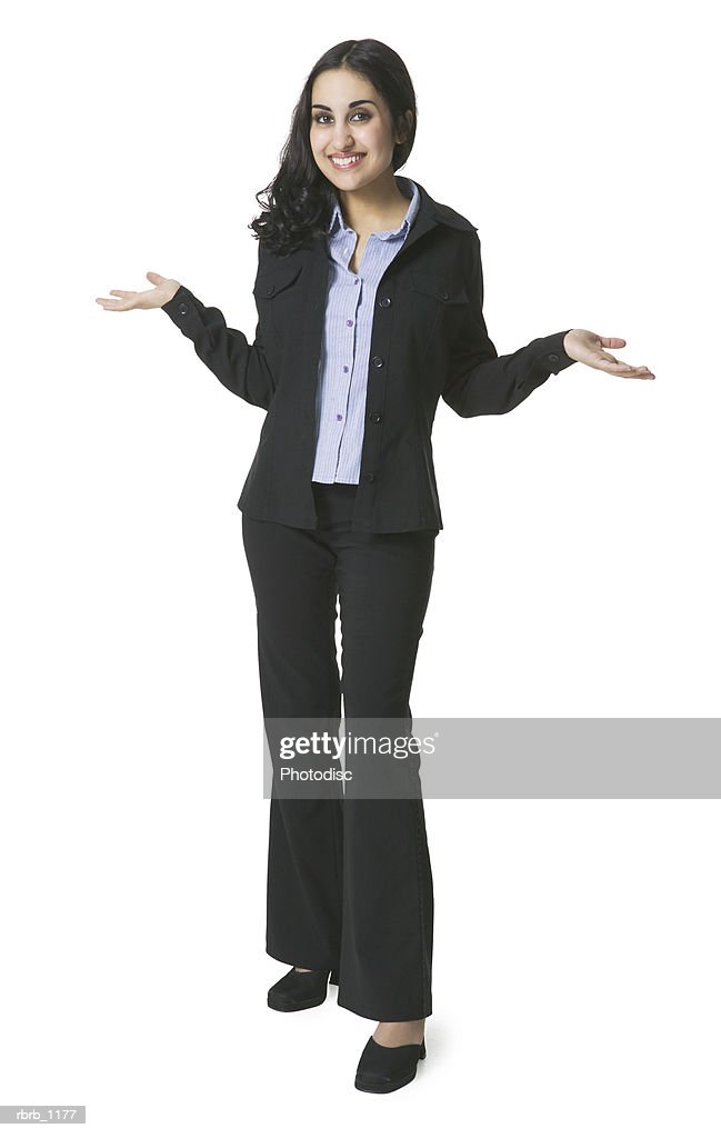 a young hispanic woman in a black suit with a blue blouse shrugs her shoulders and gestures with her hands : Stockfoto