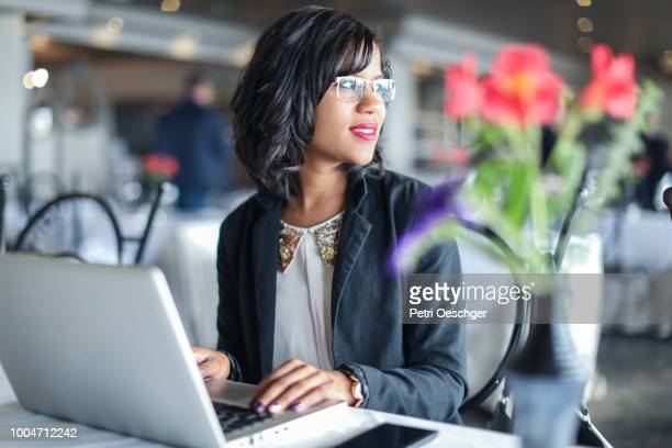 a young indian woman working in a restaurant. - business finance and industry stock pictures, royalty-free photos & images