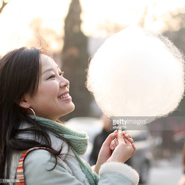 a young lady with a big cotton candy