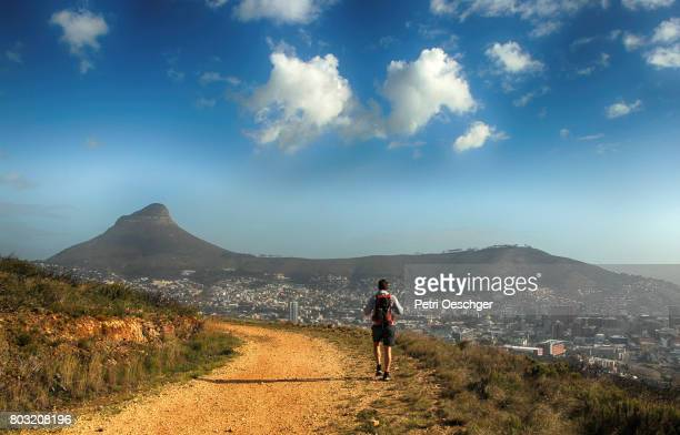 a Young man hiking up Devils Peak in Cape Town, South Africa.