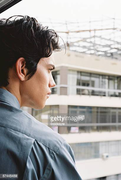 a young man looking out the window
