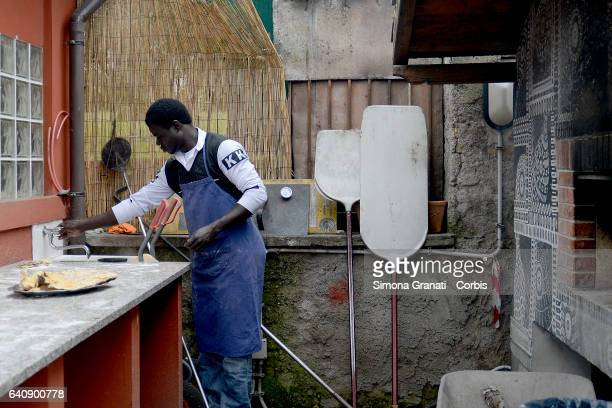 ROME ITALY FEBRUARY a young refugee cooking at the presentation of Meal Suspended at tCasetta Rossa in Garbatellaon February 2 2017 in Rome Italy The...