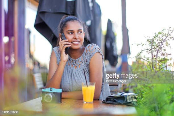 a Young woman at a restaurant.