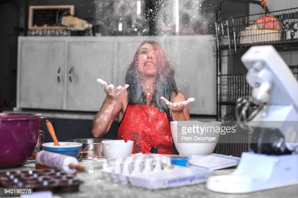 a young woman baking in the kitchen at home. - chaos stock pictures, royalty-free photos & images