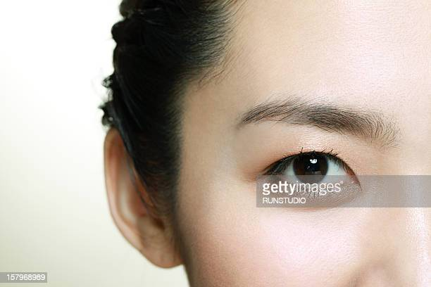a young woman looking - black eye stock pictures, royalty-free photos & images