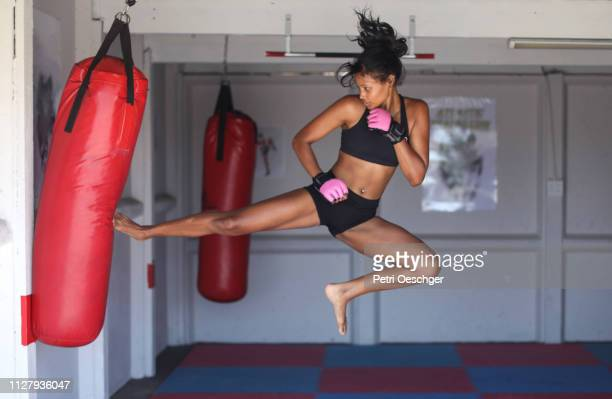 a young woman training for combat sports. - mixed martial arts stock pictures, royalty-free photos & images