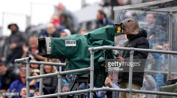 Aa cameraman gets into the spirit of the party stand by wearing a Walrus mask during day three of the 4th Investec Test Match between England and...