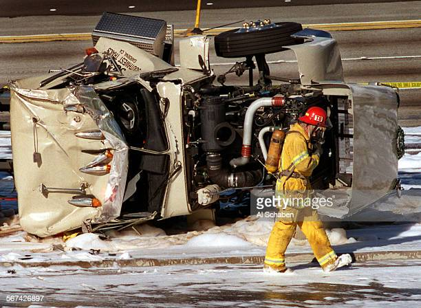 AA91bigrigcrash11220AS––ANAHEIM––An Anaheim fire captain surveys the scene of an early–morning tractor trailer accident on the East–bound 91 freeway...