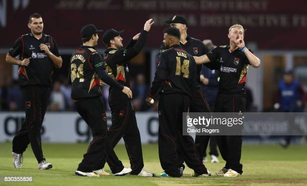 Aadil Áli of Leicestershire is congratulated by team mates after catching Richard Levi during the NatWest T20 Blast match between the...