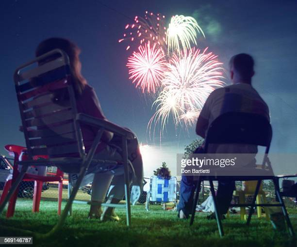 AAFireworksSeatedDB7/3/96Orange Members and friends sit in the front yard of the Graham family home and watch the fireworks show from Fred Kelly...