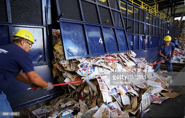 AAGarbagePaperDB9/10/97HuntingtonBeach Workers gaff an avalanche of paper products pouring out of a storage bin The paper was sorted from garbage at...