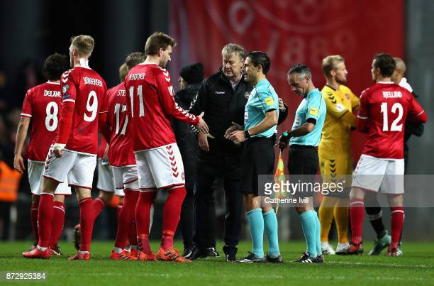 Aage Hareide Manager of Denmark and Nicklas Bendtner of Denmark shake hands with the referee during the FIFA 2018 World Cup Qualifier PlayOff First...