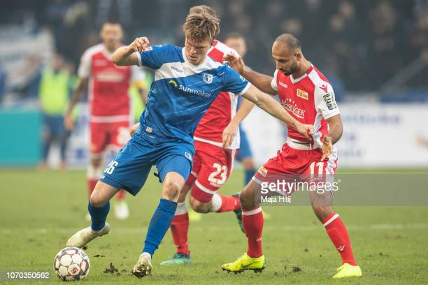 AAkaki Gogia of 1FC Union Berlin battles for possession with Marius Buelter of 1FC Magdeburg during the Second Bundesliga match between 1 FC...