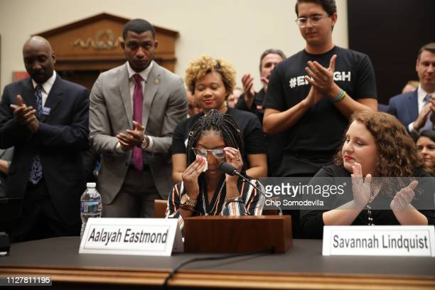 Aalayah Eastmond a survivor of the mass shooting at Marjory Stoneman Douglas High School in Parkland Florida wipes away tears as she receives a...