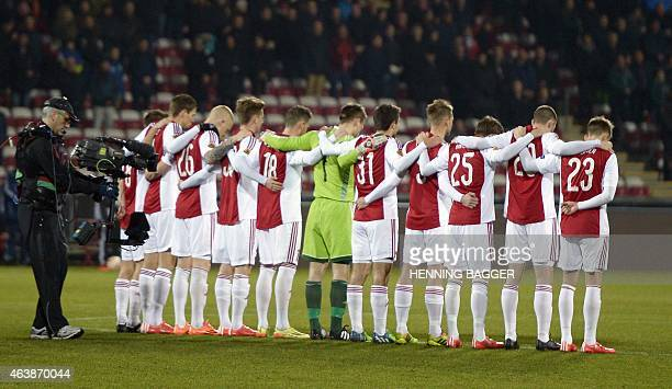 Aalborg players observe a minutes silence to honor the victims from terror attacks in Copenhagen before the Aalborg BK v Club Brugge KV during UEFA...