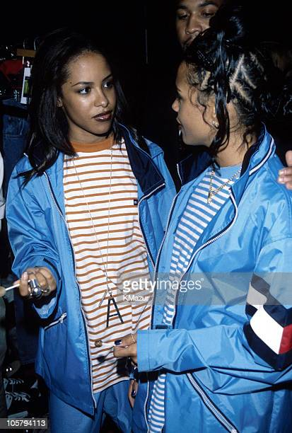 Aaliyah and guest during Tommy Hilfiger Fall 2000 Fashion Show Backstage at Macy's in New York City New York United States