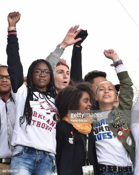 Aaliyah Eastmond, Noami Wadler and Emma Gonzalez pose onstage with students at March For Our Lives on March 24, 2018 in Washington, DC.