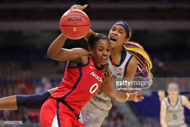Aaliyah Edwards of the UConn Huskies reaches over Trinity Baptiste of the Arizona Wildcats during the third quarter in the Final Four semifinal game...