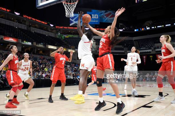 Aaliyah Patty of the Ohio State Buckeyes blocks a shot by Ashley Owusu of the Maryland Terrapins during the Championship game of Big Ten Women's...