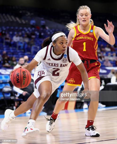 Aaliyah Wilson of the Texas A&M Aggies drives to the basket past Madison Wise of the Iowa State Cyclones during the first half in the second round...
