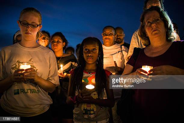 Aaliyah Wright participates in a candle lit vigil for Trayvon Martin, the teenager who was shot and killed in Florida last year, on July 15, 2013 in...