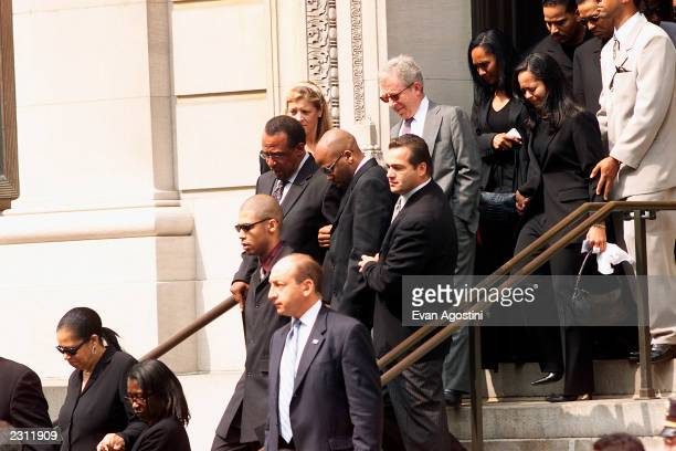 Aaliyah's brother and boyfriend Damon Dash follow the casket being carried out of St Ignatius Loyola Roman Catholic Church in New York City 8/31/2001...