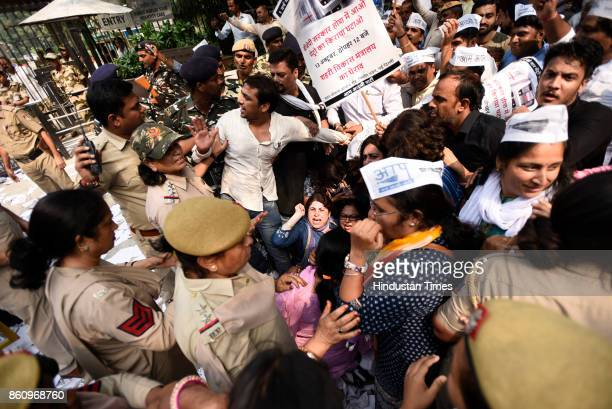 Aam Aadmi Party activists and volunteers scuffle with police during a protest against metro fare hike outside Nirman Bhawan on October 13 2017 in New...