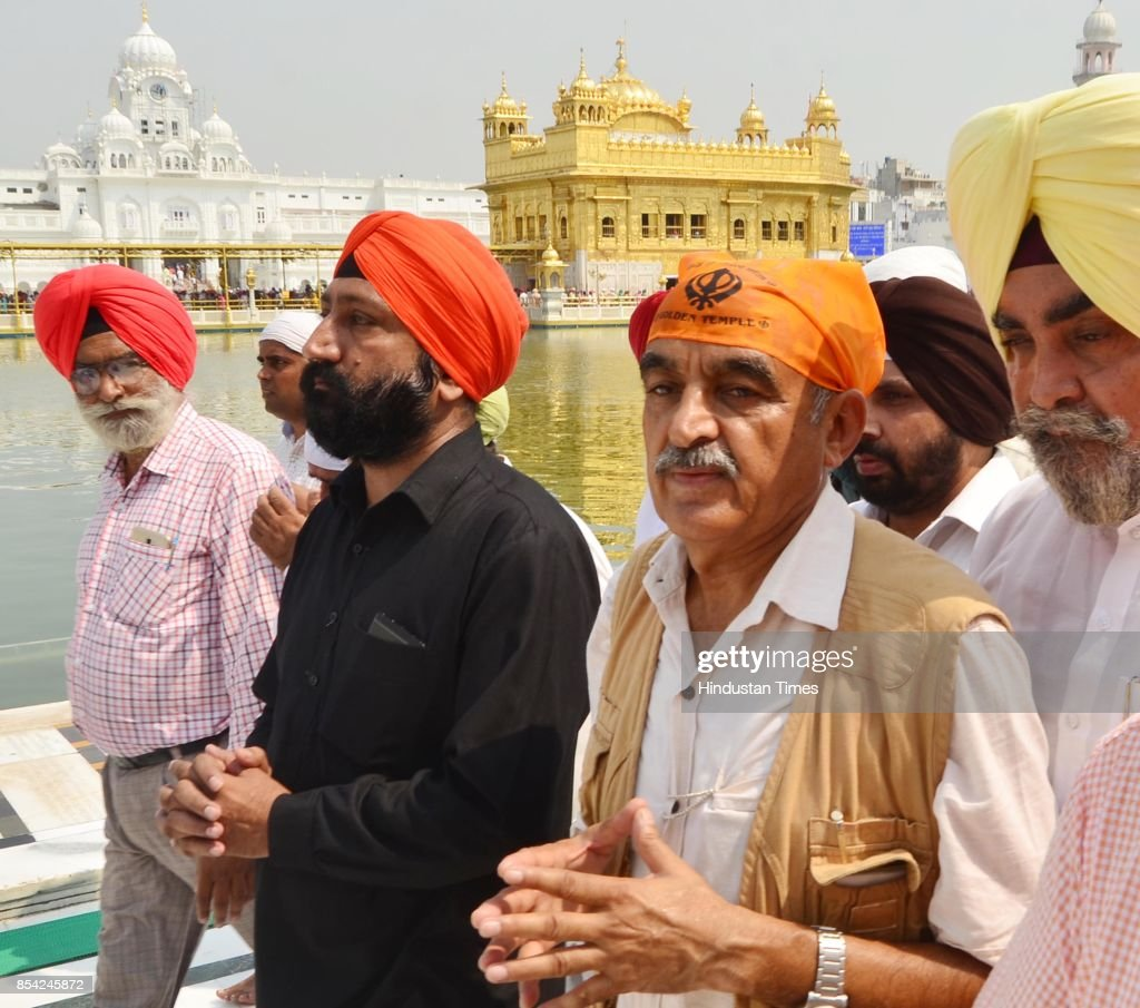Aam Aadmi Party candidate for Gurdaspur Lok Sabha Bypoll Major General Retd Suresh Khajuria with party leaders pays obeisance at Golden Temple on...