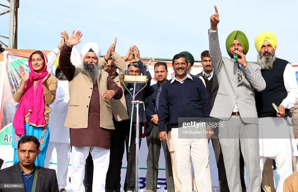 Aam Aadmi Party candidate Jarnail Singh Delhi Chief Minister Arvind Kejriwal and Punjabi Singer Sukhwinder Sukhi during an election campaign rally on.