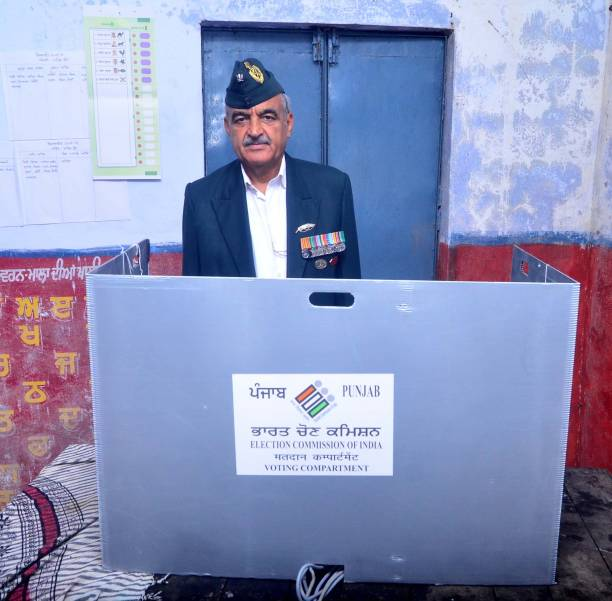 Aam Aadmi Party candidate Maj Gen Suresh Khajuria casts his vote at polling station during Gurdaspur Lok Sabha bypoll at village Pangoli on October...