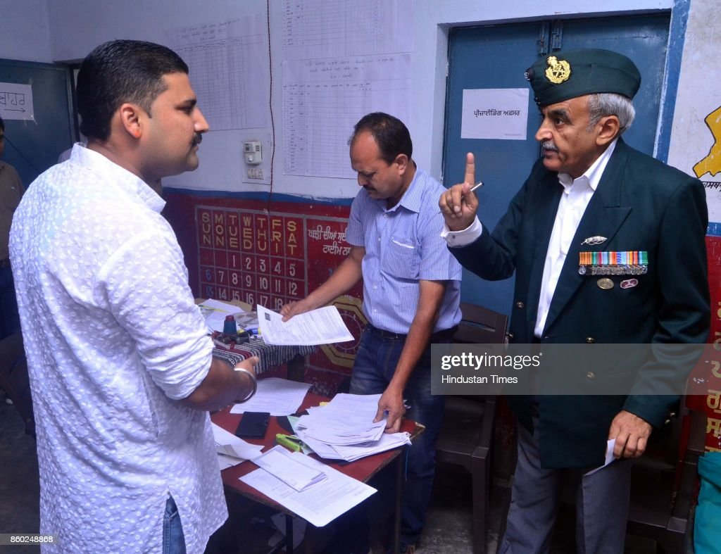 Aam Aadmi Party candidate Maj Gen Suresh Khajuria having verbal spate with Congress worker inside the polling station during Gurdaspur Lok Sabha...