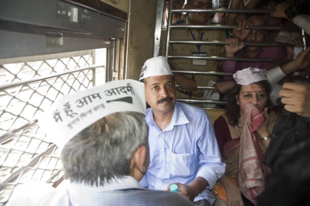 Aam Aadmi Party chief Arvind Kejriwal with Meera Sanyal in local train at mumbai, Maharashtra, India, Asia