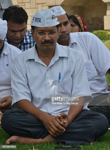 Aam Aadmi Party convener Arvind Kejriwal along with party MLAs at Rajghat in New Delhi