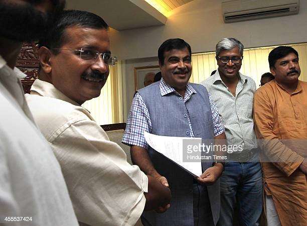 Aam Aadmi Party convener Arvind Kejriwal with Union Minister for Road Transport and Highways Nitin Gadkari during a meeting on regularizing...
