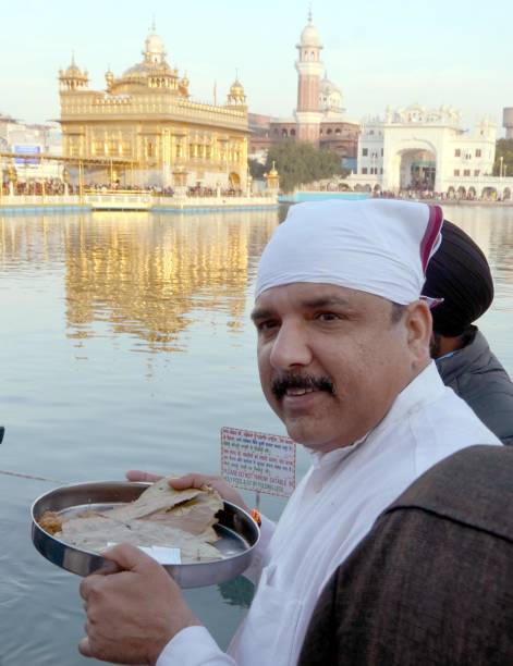 Aam Aadmi Party Leader and Rajya Sabha Member Parliament Sanjay Singh paying obeisance at Golden Temple on February 17 2018 in Amritsar India