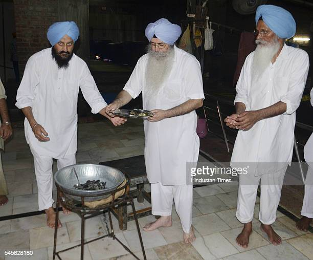 Aam Aadmi Party leader and senior advocate HS Phoolka washes utensils at Langar hall of Golden Temple, on July 10, 2016 in Amritsar, India. A week...