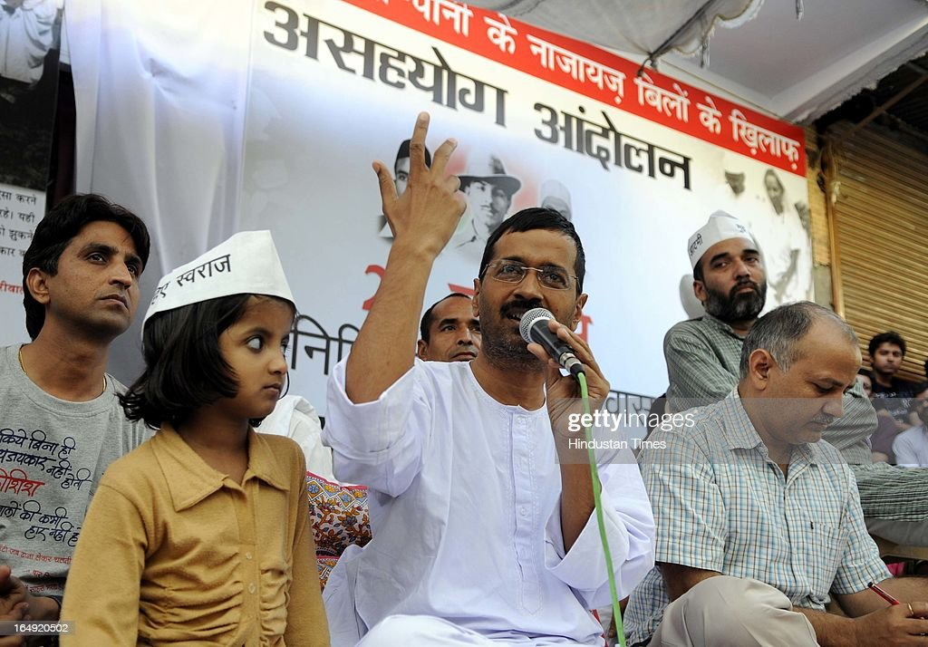 Aam Aadmi Party leader Arvind Kejriwal addressing the crowd assembled at Sundar Nagari on March 29, 2013 in New Delhi, India. Arvind Kejriwal, said the prices of power and water in Delhi had gone up many times because of corruption of Sheila Dikshit Government. Responding to the allegation made by Delhi Chief Minister that people can't use 24 hours power supply and pay only for 8 hours, Arvind Kejriwal challenged Shiela Dikshit for an open debate anywhere anytime in front of the people of Delhi.