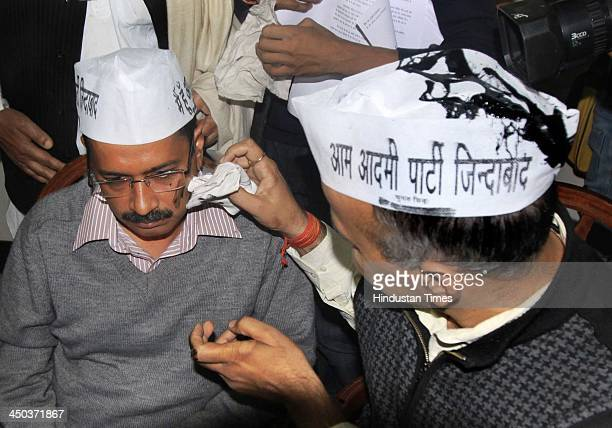 Aam Aadmi Party leader Manish Sisodia cleaning the face of Arvind Kejriwal after a man who claimed to be Nachiketa Walnekar threw black ink at AAPs...
