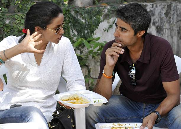Aam Aadmi Party Lok Sabha candidate from Chandigarh Gul Panag with her husband Rishi Attari at her residence a day after polling on Apriil 11 2014 in.