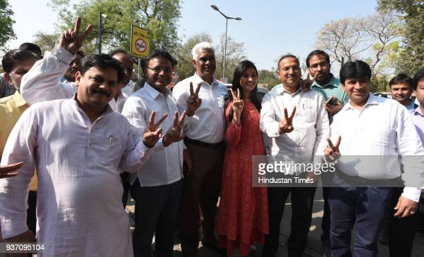 Aam Aadmi Party MLA Alka Lamba and others flash a victory sign after Delhi High Court restored the membership of 20 AAP MLAs in the office of profit...