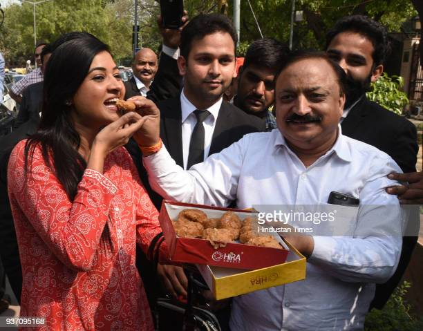Aam Aadmi Party MLAs Rajesh Rishi and Alka Lamba celebrate after Delhi High Court restored the membership of 20 AAP MLAs in the office of profit case...