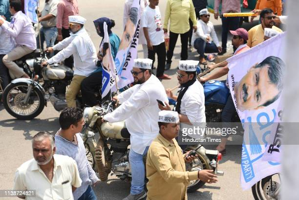 Aam Aadmi Party supporters ride on motorcycles during the road show of AAP candidate for East Delhi Atishi Marlena before filing her nomination...